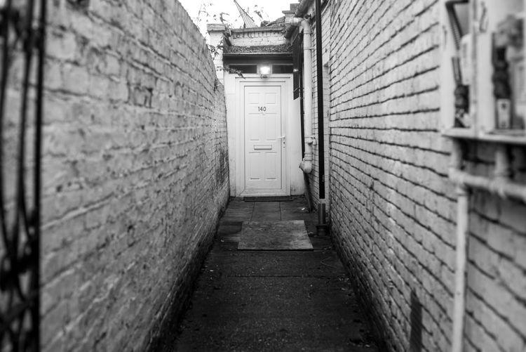 104 EyeEmNewHere London Alley Arcade Architecture Blackandwhite Brick Cellar Corridor Door Wall