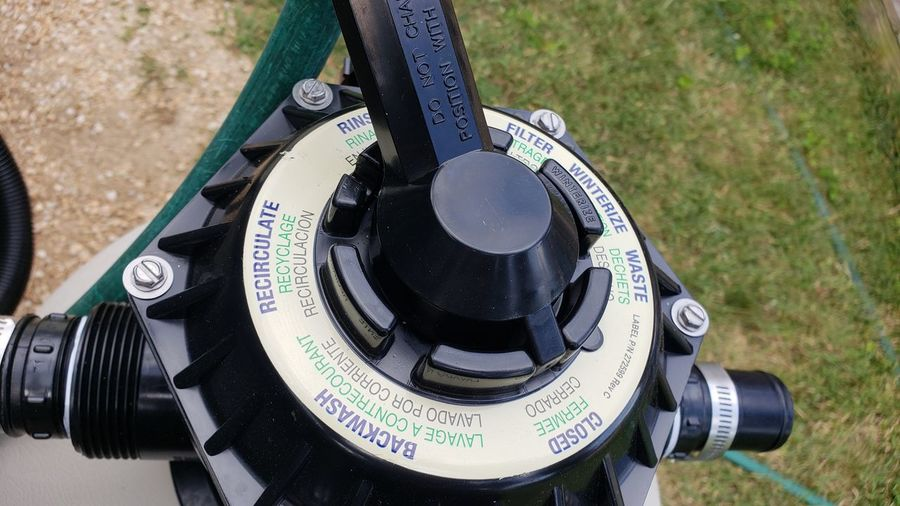 Close-up of valve with text