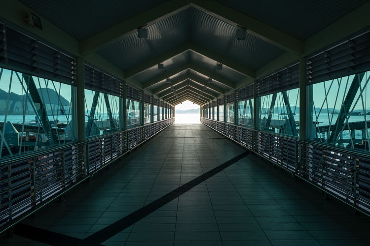 Langkawi Architecture Built Structure Railing Indoors  No People The Way Forward Day Diminishing Perspective Direction Sunlight Bridge Transportation Connection Footpath Bridge - Man Made Structure Nature Lighting Equipment Ceiling Empty Footbridge