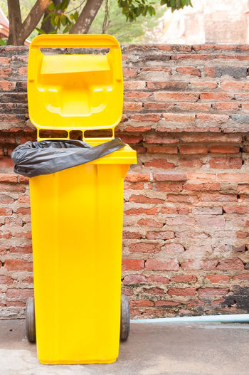 Close-up of yellow box on stone wall