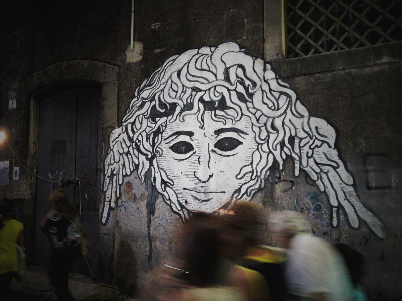 CLOSE-UP OF GRAFFITI ON STONE WALL