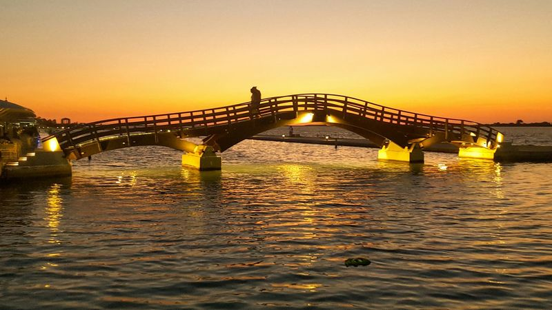 Sunset Bridge Connection Architecture Water Sea River Cityscape Illuminated Port Silhouette Lefkas Lefkada GreeceVacations Travel Destinations Night Orange Color Orange Sunset Marina Harbor Harbour Outdoors Let's Go. Together. Paint The Town Yellow Lost In The Landscape