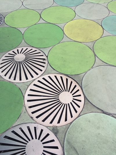 Water Drain Green Color Art And Craft High Angle View Multi Colored No People Design Pattern Full Frame Shape Creativity Flooring Close-up Floral Pattern Tiled Floor Outdoors Day Circle Geometric Shape Backgrounds