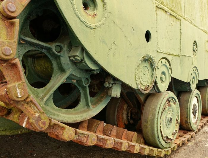 The continuous track of a World War Two landing craft Abandoned Damaged Land Vehicle Landing Craft Military Equipment Obsolete Run-down Rusty Sprocket Tank Tracks Vintage World War II