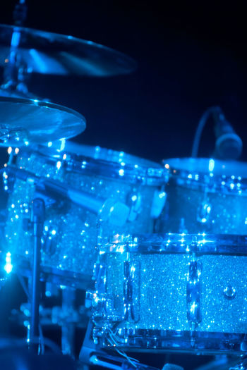 Arts Culture And Entertainment Illuminated Music Night Blue Nightlife No People Musical Instrument Close-up Nightclub Event Still Life Musical Equipment Light - Natural Phenomenon Shiny Focus On Foreground Rock Music Concert Stage Drums Drum Set Drumset Band Musical Concert Dark