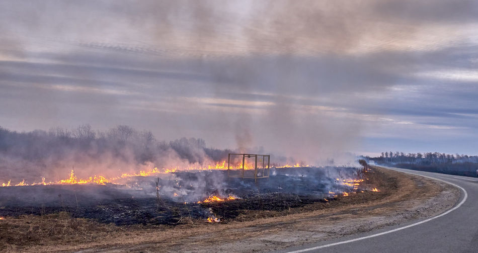 Panoramic shot of fire on road against sky