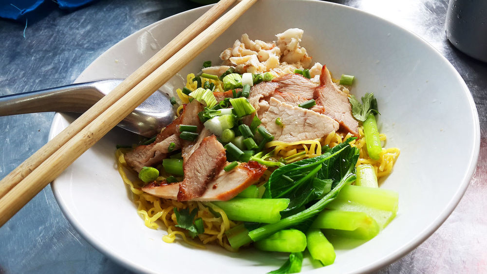 Thai style noodle with pork and vegetable. Noodles Bowl Chopsticks Close-up Day Delicious Food Food And Drink Food Stories Freshness Healthy Eating High Angle View Indoors  Meat No People Ready-to-eat Street Food Thai Street Food Thai Style Vegetable บะหมี่หมูแดง