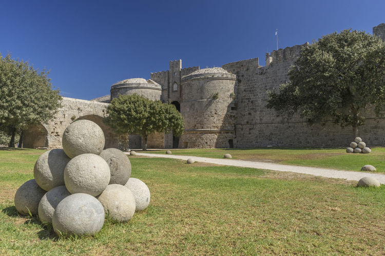 Fortifications, moat and walls of the old town, Rhodes, Greece with stone canon balls Canon Balls Fortifications Rhodes Greece Architecture Built Structure Day History Moat Moat Around The Fortress No People Old Town, Rhodes Outdoors Stone Canon Balls Travel Destinations