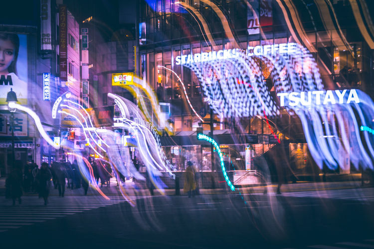The Glitch Imperfection Neon Shibuya Shibuyascapes Color Redefining Winter Futuristic Technology Tech Lights Colors Atmospheric Mood Tokyo Japan Intersection Shibuya Crossing Urban Zebra Crossing Exceptional Normalcy Illuminated Night City Motion Blurred Motion Architecture Street Glass - Material Building Exterior Store Transparent Window Long Exposure No People Built Structure Reflection Retail  Text Nightlife Humanity Meets Technology My Best Photo