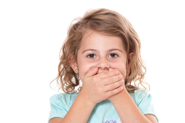 Young girl keeps her mouth shut. All on white background. Child Childhood Curly Hair Girl Girlhood Isolated On White Isolated White Background Kid No Talking No Talking Please. One Person Shut Your Mouth Silence Silent Studio Shot White Background Young Girl