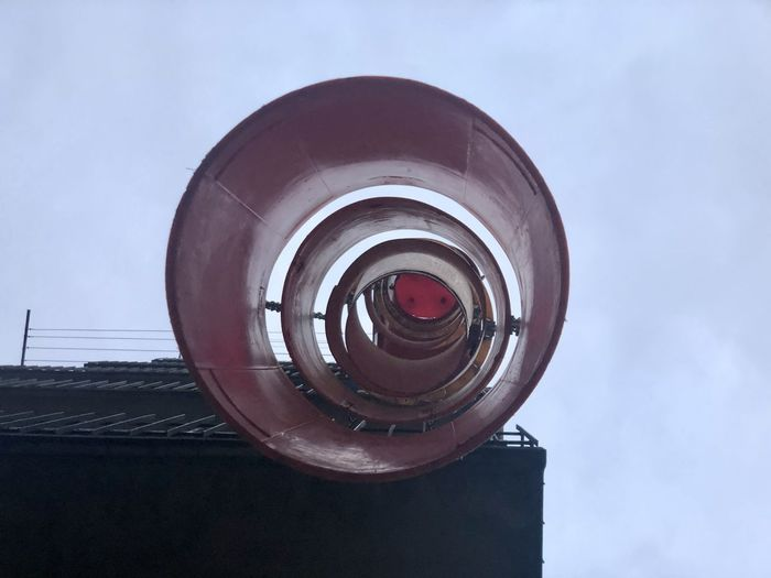 Low angle view of camera against sky