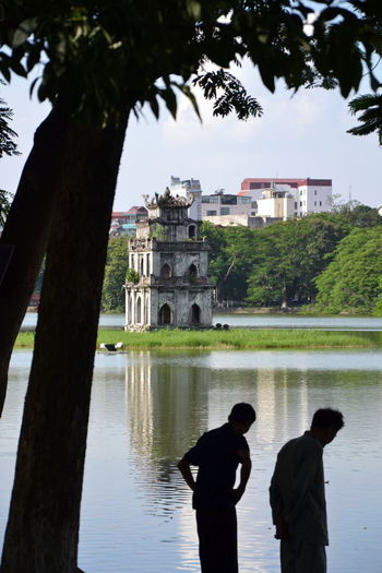 Architecture Building Exterior Built Structure Day Hanoi Hanoi Vietnam  Hoan Kiem Lake Lake Of The Returned Sword Men Nature Outdoors People Real People Rear View Silhouettes Sky Tháp Rùa Tree Turtle Tower Two People Vietnam Travel Vietnam Trip Water Women