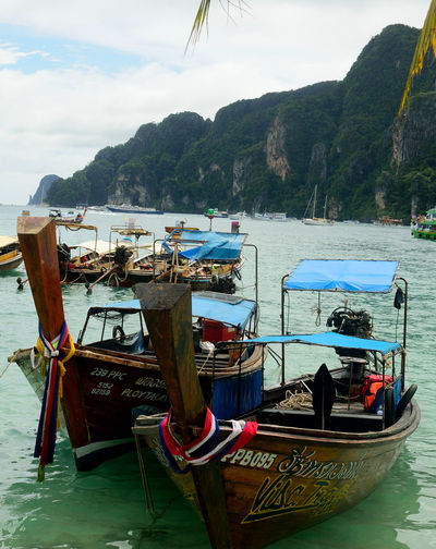 Backpacking Beauty In Nature Blue Water Day Island Ko Phi Phi Koh Phi Phi Long Boat Mountain Nature Nautical Vessel No People Outdoors Sea Sky Thailand Transportation Tropical Water