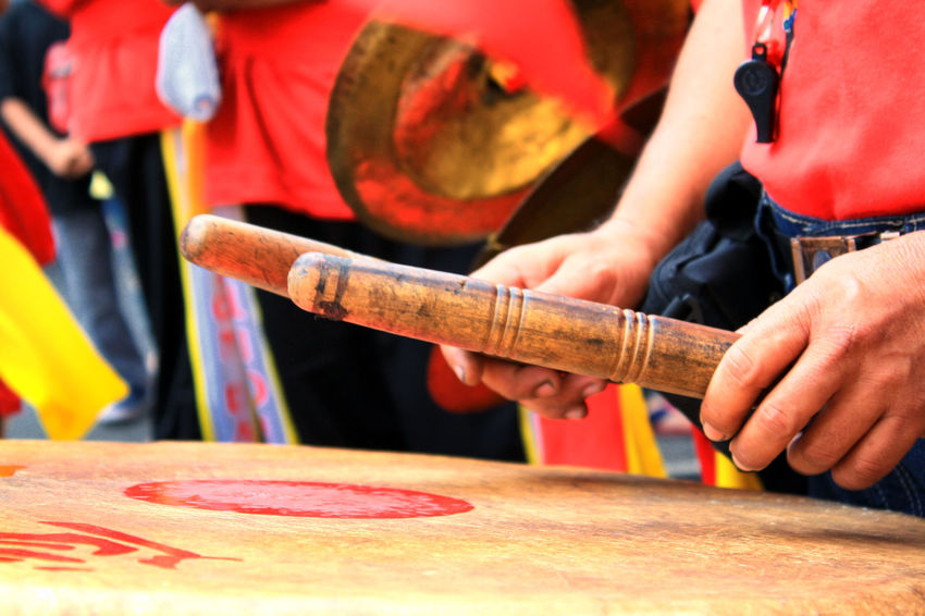 Drums that accompany Liong attractions Drum Chinese Culture Chinese New Year Close-up Day Drumstick Focus On Foreground Human Hand Imlek Men Midsection Musical Instrument Occupation One Person Outdoors People Real People Standing