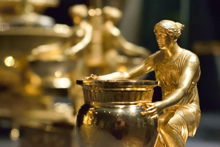 Sculpture of women statue iin gold