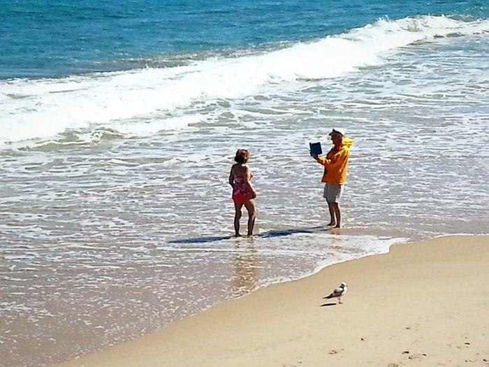 """Smile honey!"" Beach Photography Senior Adult Technology Everywhere Tablet Man Taking Picture Couple On Beach Enjoying Life Ocean Waves"