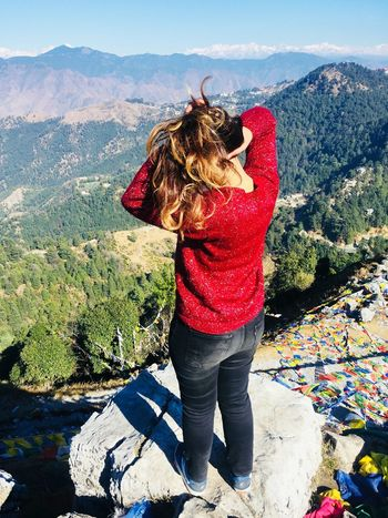 Beauty lies in the eyes of the beholder. Winters Woollens Red Rock Trees Black Jeans Uttrakhand Cloud - Sky Prayer Flags  Tieing Her Hair Golden Hair  Tree Clouds And Sky One Person People Adult Adults Only Women Only Women One Woman Only Mountain Day Outdoors Standing Red Mountain Range Nature Real People Warm Clothing Sky EyeEmNewHere EyeEm Ready