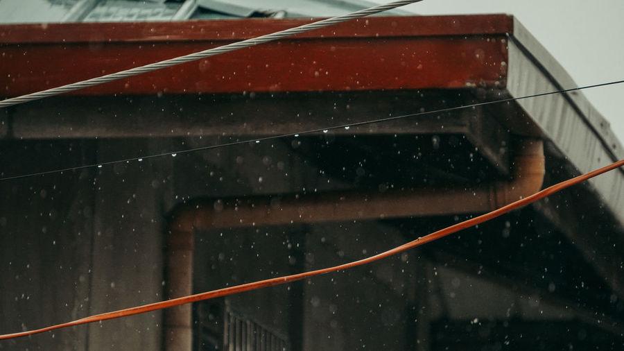 Close-up of wet railing during rainy season