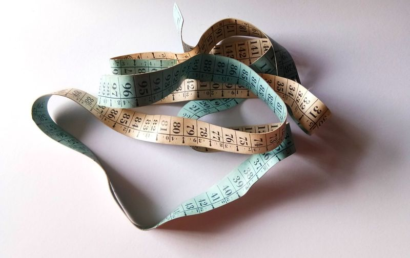 Measuring tape on blue paper background. Selective focus. Indoors  No People Close-up Day