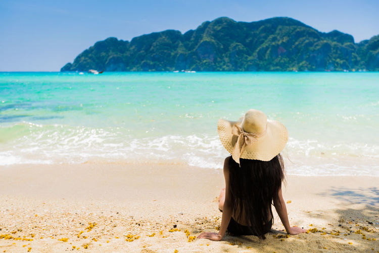 Adult Beach Beauty In Nature Day Hair Hairstyle Horizon Over Water Land Leisure Activity Lifestyles Nature One Person Outdoors Real People Rear View Scenics - Nature Sea Sky Tranquil Scene Tranquility Water Women