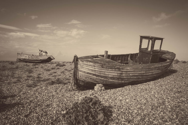 Abandoned.... Abandoned Black And White Boat Damaged Dungeness Kent Mode Of Transport Moored Nautical Vessel Obsolete Old Outdoors Ruined Run-down Shiny Stranded Structure Transportation Wood Wood - Material