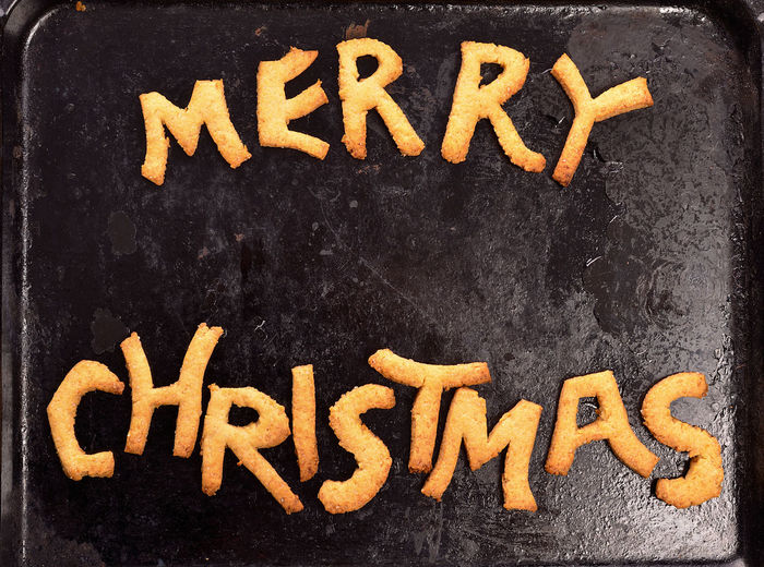 Merry Christmas cookies on an old baking plate Baking Plate Baking Sheet Black Color Blackboard  Christmas Christmas Bakery Close-up Cookies Food Homemade Merry Christmas! Message No People Old Sweet Talcum Powder Text Used Water