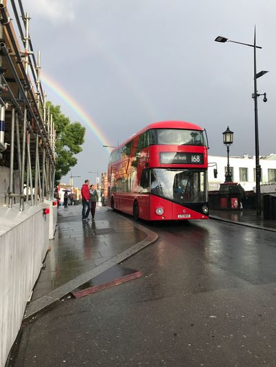 Transportation Real People Day Outdoors Redbus Londonbus Streetphotography Sky Rainbow Rainbow Colors