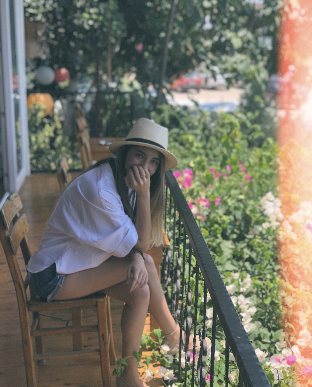 hat, plant, clothing, women, one person, day, real people, lifestyles, leisure activity, females, adult, girls, smiling, casual clothing, sun hat, young adult, young women, growth, front or back yard, outdoors