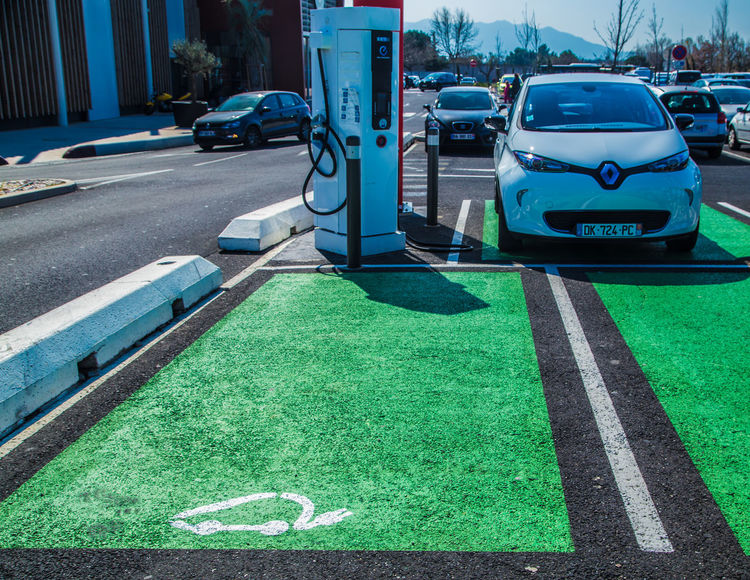 Clean Energy Electric Car Parking Electric Cars Green Green Green!  How Do We Build The World? No Pollution Pollution? Renewable Energy