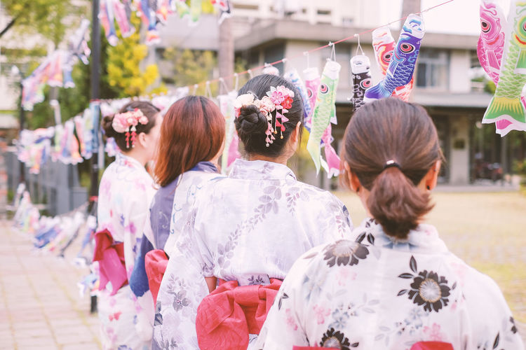 Women Wearing Kimono While Standing On Street