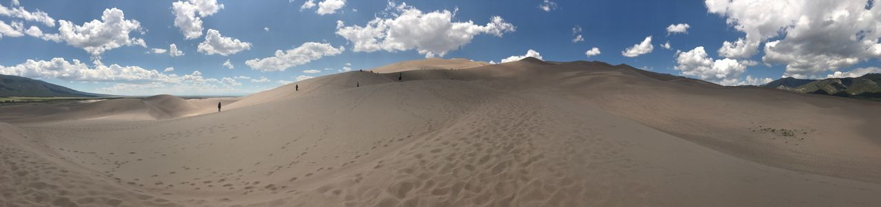 Great sand dunes panoramic Sky Scenics - Nature Cloud - Sky Land Sand Beauty In Nature Landscape Mountain Tranquility Non-urban Scene Tranquil Scene Environment Desert Nature Panoramic Arid Climate Sand Dune Physical Geography No People Mountain Range