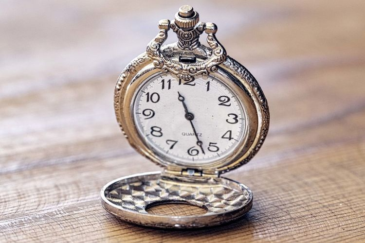Silver Pocket watch Clock Time Pocket Watch Instrument Of Time Watch Antique Table Close-up No People Indoors  Focus On Foreground Metal Still Life Number Wood - Material Accuracy Single Object Minute Hand History Personal Accessory Clock Face Silver Colored Luxury