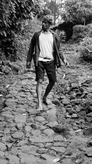 Urang Kanekes (People of Kanekes) or People of Badui, a self-isolated community in the province of Banten, Indonesia. Baduy Kanekes Banten Isolated Culture Heritage Blackandwhite Snapshot Daily Life Full Length Men Standing Walking Casual Clothing