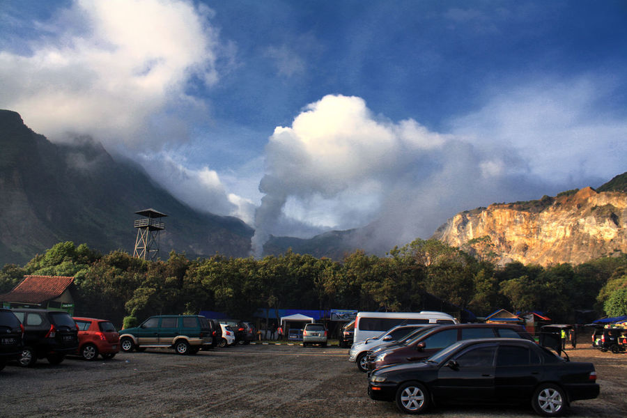Mount Papandayan seen from Parking Area Architecture Beauty In Nature Car Cloud - Sky Day Land Vehicle Landscape Mode Of Transport Mountain Nature No People Outdoors Road Scenics Sky Transportation Tree Volcano