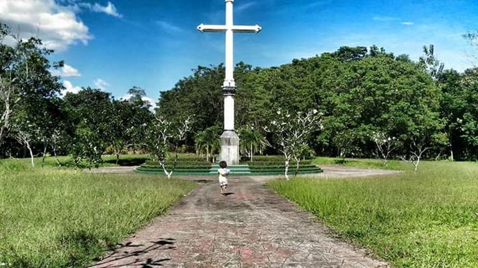 Religion Cross Tree Cloud - Sky Crucifix Sky No People Grass Outdoors Place Of Worship Day Statue Close-up Young Adult One Young Woman Only Kid Kids Happykids Daughter Happiness My World Nature Lovelynatureshots