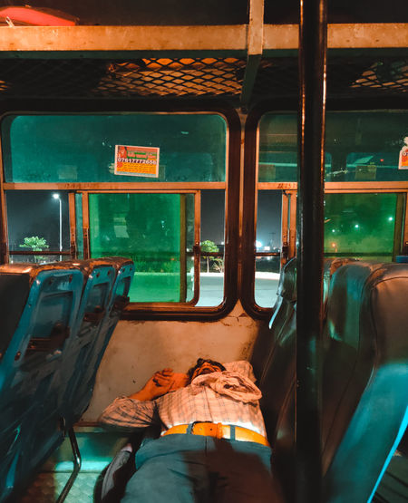 Done for the week ... Green Color Glass - Material Travel Mobilephotography Delhi Haryana Bus Tired Weekend Lowlight Light And Shadow Lighting Ambient Light Exploring Man Young Adult Seats Window Night Dark Traveling Rusty Weathered Deterioration Damaged Bad Condition Peeled Broken Ruined Civilization The Portraitist - 2019 EyeEm Awards The Photojournalist - 2019 EyeEm Awards The Mobile Photographer - 2019 EyeEm Awards The Traveler - 2019 EyeEm Awards