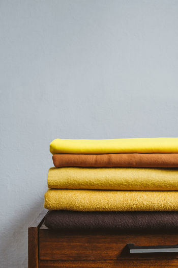 Color of the year 2021. illuminating and ultimate gray. stack of yellow cloth