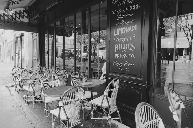 Streetphotography Street Seat Cafe Table Chair Sign City Architecture Restaurant Empty Reflection No People Building Exterior Outdoors Day Western Script Glass - Material Lifestyles Life Blackandwhite Communication Business Transparent Europe