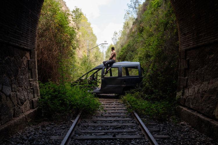 Man on abandoned rails