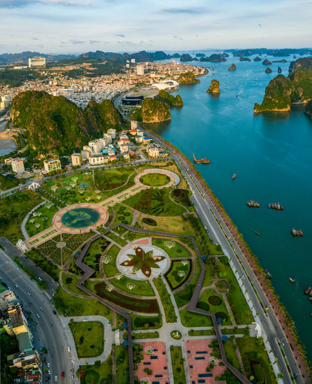 Ha Long Bay Ha Long City Aerial View Architecture High Angle View City Sea Sky Travel Destinations Plant Cityscape Building Exterior Flower Park Island Boat Land Road Water