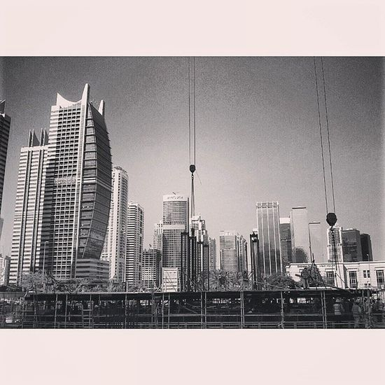The work never stops UAE Dubai JLT Jumeirah laketowers construction highrise skyscrapers buildings 24/7 labour architecture blackandwhite photography workers