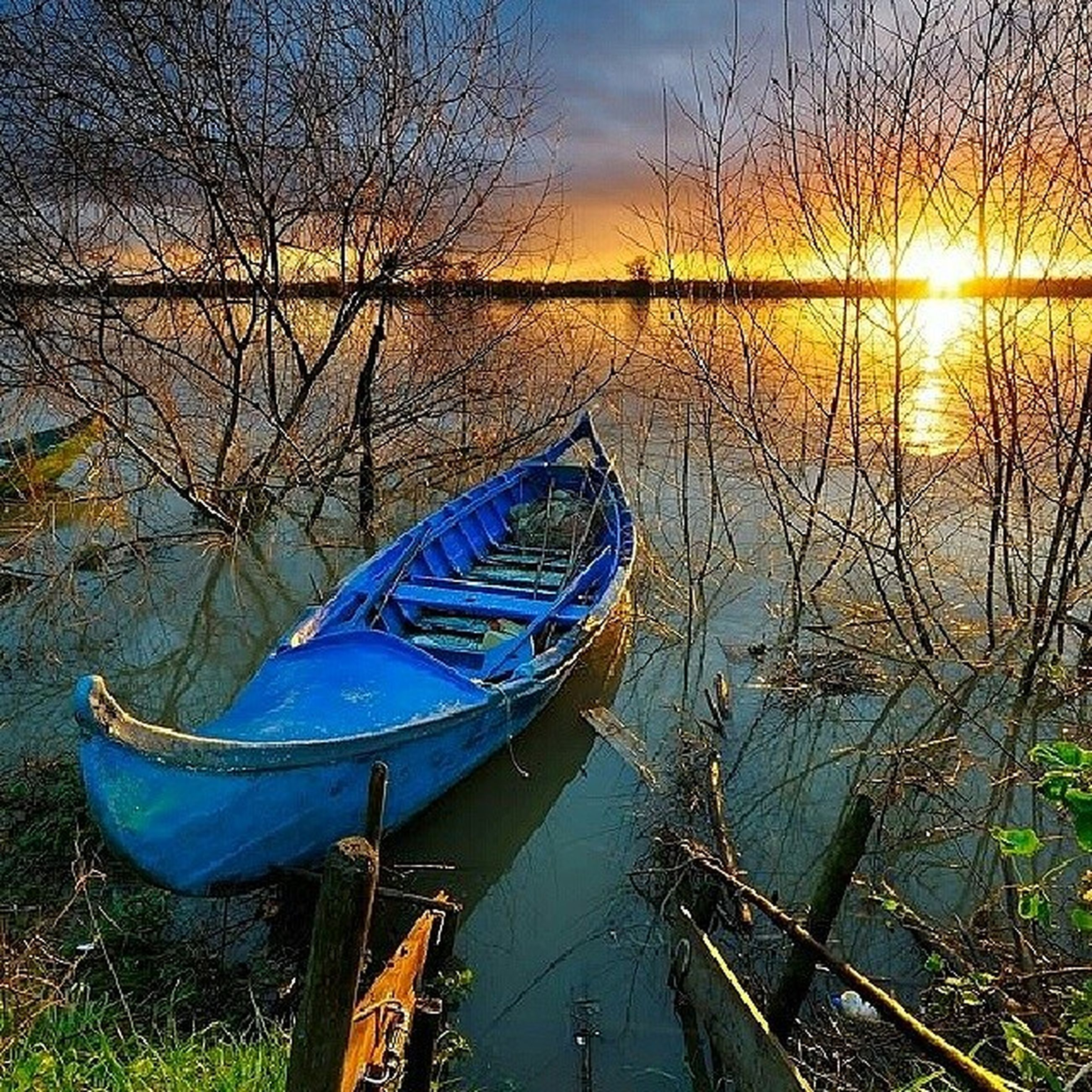 nautical vessel, boat, water, transportation, mode of transport, moored, tranquility, tranquil scene, sky, beauty in nature, scenics, nature, lake, sunset, reflection, tree, travel, sea, sunlight, idyllic
