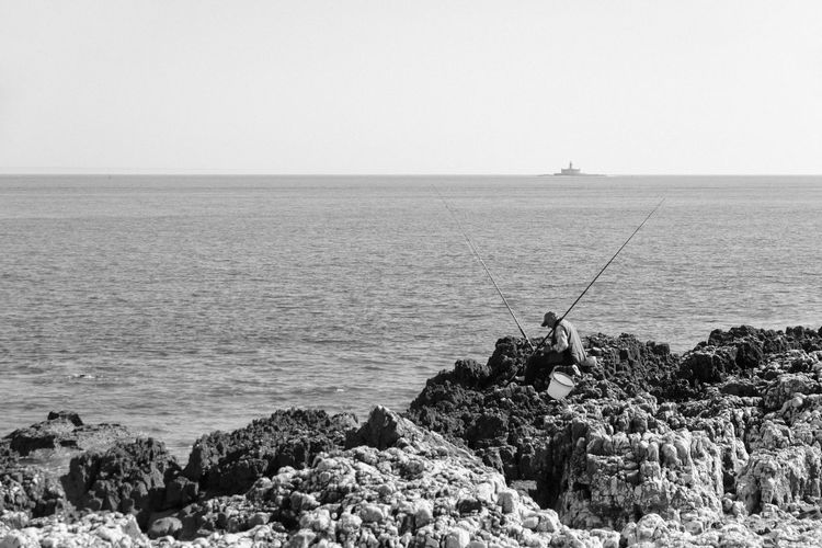 On the Rocks Beauty In Nature Clear Sky Day Fisherman Fishing Fishing Pole Fishing Rod Fishing Tackle Fishing Time Horizon Over Water Idyllic Men Nature One Person Outdoors People Portugal Real People Rocks Scenics Sea Sky Tranquil Scene Tranquility Water