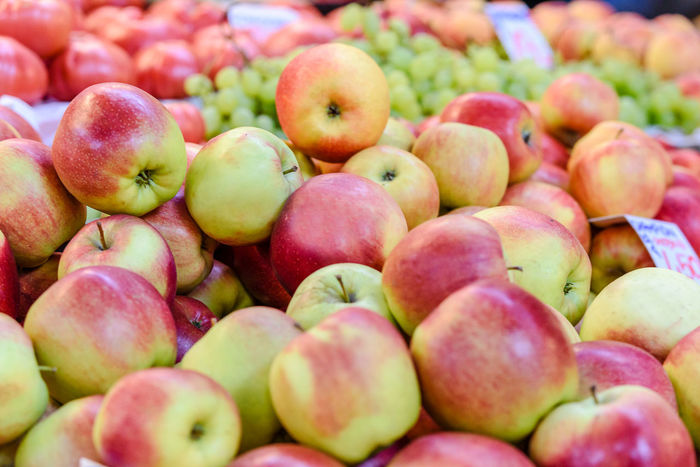 Apples and other fruits for sale at the market. Agriculture Bazaar Farm Grocery Shopping Standing Supermarket Vitamins Apples Basket Close-up Food Food And Drink Freshness Fruit Greengrocery Healthy Eating Large Group Of Objects Market Organic Retail  Row Store Traditional