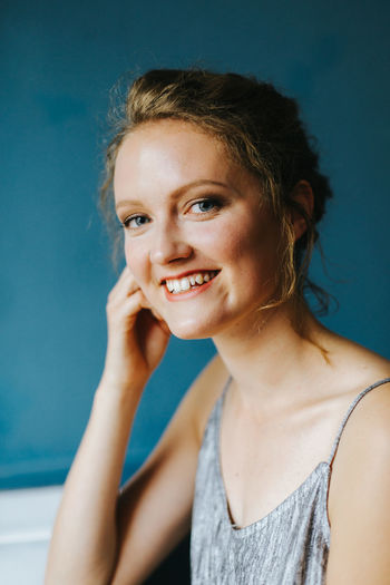 Portrait Of Smiling Young Woman At Cafe