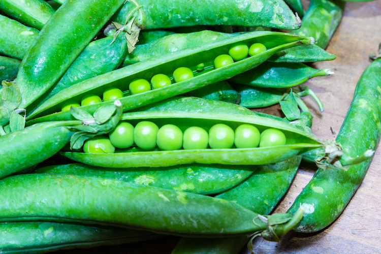 High angle view of green chili peppers in market