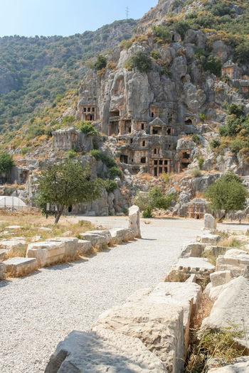 Lycian Tombs in Myra, Turkey, Demre Demre Turkey Turkey. Demre UNESCO World Heritage Site Ancient Ancient Civilization Ancient History Archaeology Architecture Building Exterior Built Structure Day History Mountain No People Old Ruin Outdoors Rock Ruined Tombs Tourism Travel Travel Destinations Tree