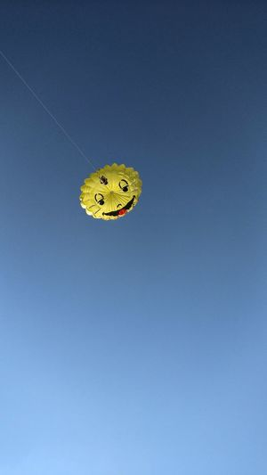 Outdoors Sky Day Communication No People Smiley Smile Parachute Parachutes Sport Air Paragliding Fun Entertainment Yellow Sports Activity Activity Smiley Faces Negative Space Up Up In The Air The Week On EyeEm Kitesurfing Kite Kite Surfing Paint The Town Yellow