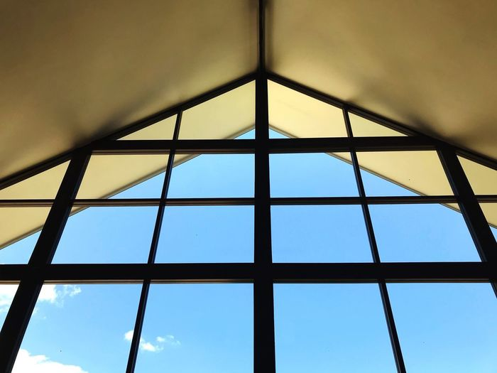 Modern gable facade mirror window wall with clear blue sky background Art Calm Sunny Environment Natural Day Light Clear View Mirror Sky Low Angle View Built Structure Architecture No People Day Pattern Nature Blue Window Skylight Design Ceiling Window Frame