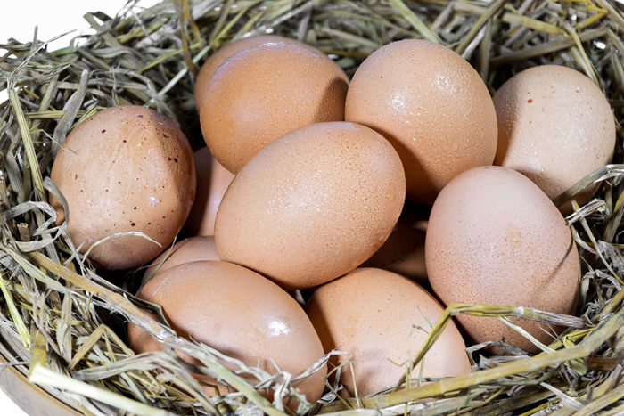 Group of eggs with straw in a bamboo basket are prepared for cooking. Animal Egg Animal Nest Bird Nest Brown Celebration Close-up Day Easter Easter Egg Egg Egg Carton Eggshell Food Food And Drink Fragility Freshness Healthy Eating Indoors  Nature New Life No People Straw
